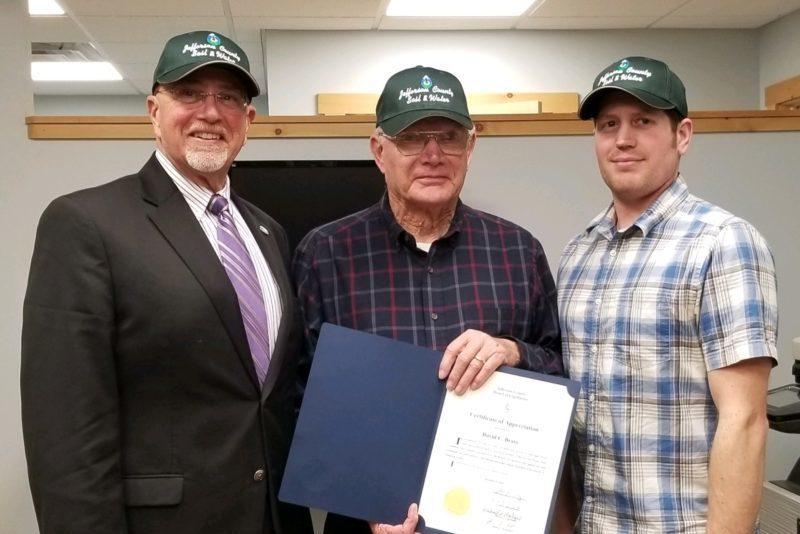 Legislator Mike Montigelli and John Peck with David Brass